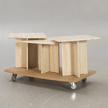 A three pcs travertine coffee table later part of the 20th century.