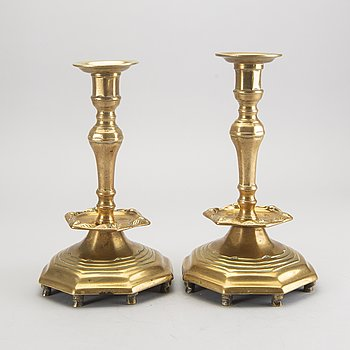 A pair of Baroque style bronze candle sticks later part of the 19th century.