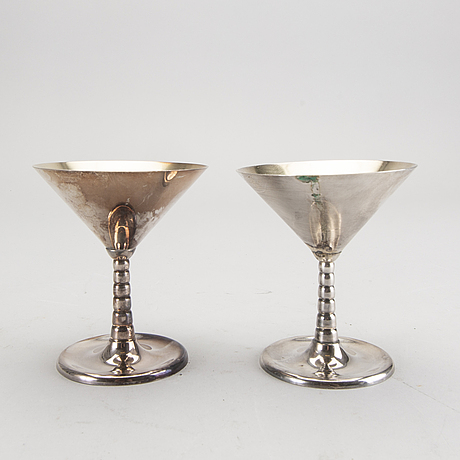 A set of 12 silver plated cocktail glasses and a shaker mark by cg hallberg stockholm mid 1900s.