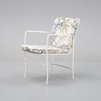 Josef Frank, a model 591 armchair from Firma Svenskt Tenn.