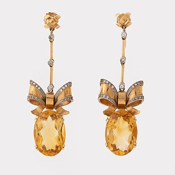 A pair of Stigbert 18K gold earrings set with faceted citrines.