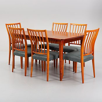 A mahogany veneered dining table and a set of six beech chairs, 1950's/1960's.