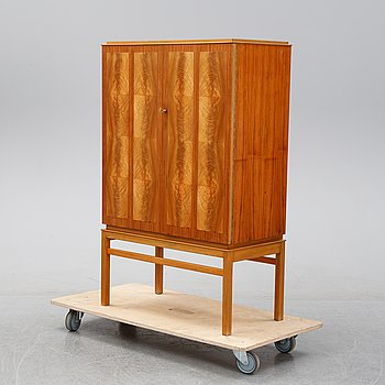 A mid 20th Century walnut veneered cabinet from Westbergs.