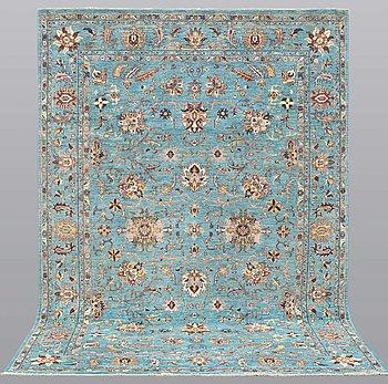 A carpet, Zieglar Design, ca 297 x 205 cm.