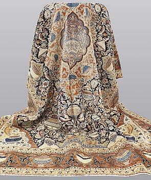 A carpet, Figural Kashmar, ca 377 x 285 cm.