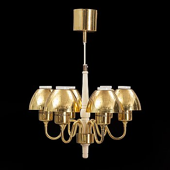 Hans-Agne Jakobsson, a brass and wood ceiling light from Markaryd.