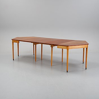 A teak veneered dining table, Denmark, mid 20th century.