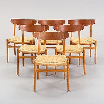 Hans J Wegner, a set of six beech and teak model CH-23 chairs, Denmark.
