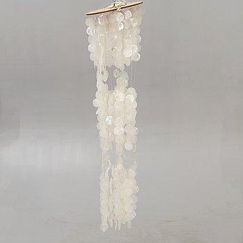 A seashell 1970s ceiling pendant.
