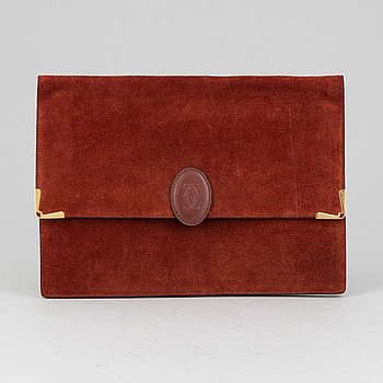 Cartier, a red suede clutch.