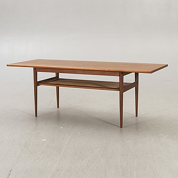 A Dansih 1960s teak and rattan  coffee table.