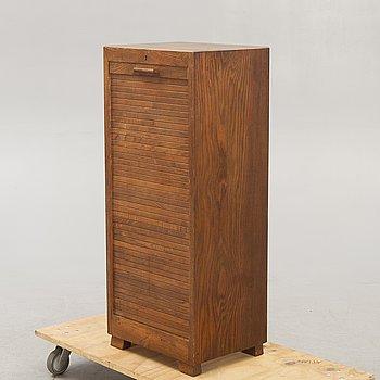 A mid 1900s oak shutter cabinet.
