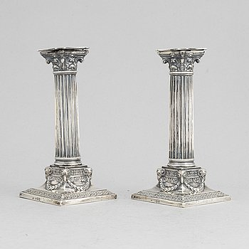 A pair of candlesticks by Martin, Hall & Co, London 1890.