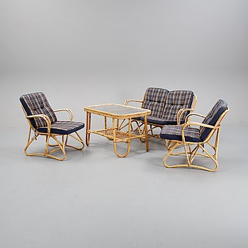 A garden rattan sofa with two armchairs and a table, mid 20th Century.