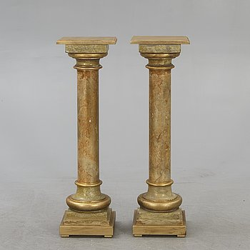 A pair of painted pedestals 20th century.
