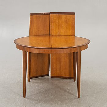 A 1960s teak and walnut dining table.