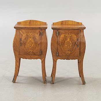 A pair of Baroque style mahogany bedside tables first half of the 20th century.