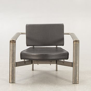 A metal and leather armchair later part of the 20th century.