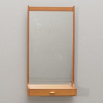 A 1960s teak wall mirror.