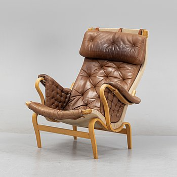 A 'Pernilla' lounge chair by Bruno Mathsson for Dux, end of the 20th Century.
