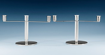 "1120. Wiwen Nilsson, A pair of Wiwen Nilsson candelabra for three candles, Lund in 1929. This model was first shown at an exhibition at ""Kulturen"" this very year."