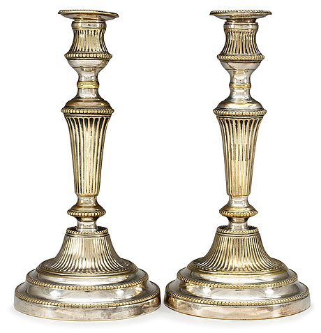A pair of 19th century silvered candlesticks.