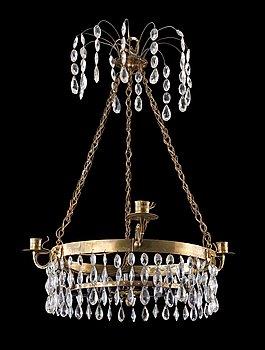 1016. A late Gustavian four-light chandelier.