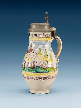 1395. A German pewter mounted faience tankard, 18th Century.