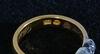 Ring, guld, 23k, med tre silverinfattade rosenstenar.