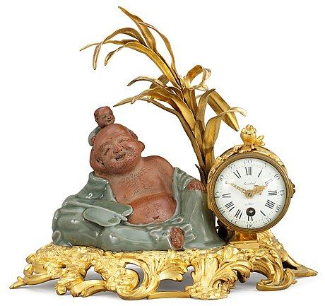 A french louis xv-style late 19th century table clock.