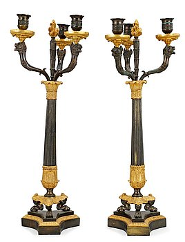 1026. A pair of three-light candelabra, late Empire-style.