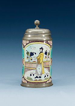 1396. A German faience pewter-mounted tankard, 18th Century.