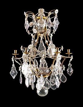 1013. A Rococo six-light chandelier.