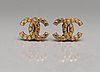 A pair of chanel earclips, prob autumn 2002.