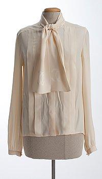 9. A Chanel silk blouse.