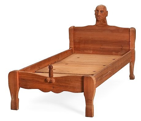 An erik höglund wooden bed, signed and dated 1969.