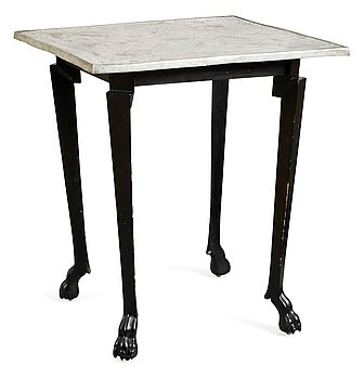 595. An Anna Petrus table, Stockholm circa 1922; pewter top and black wooden legs.