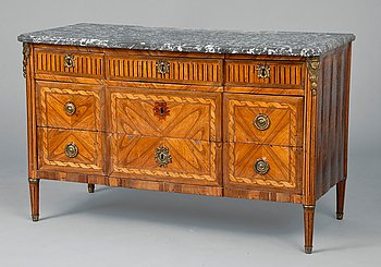 15. A COMMODE.