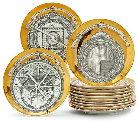 A set of twelve piero fornasetti 'astro labio' porcelain plates, milan, italy.