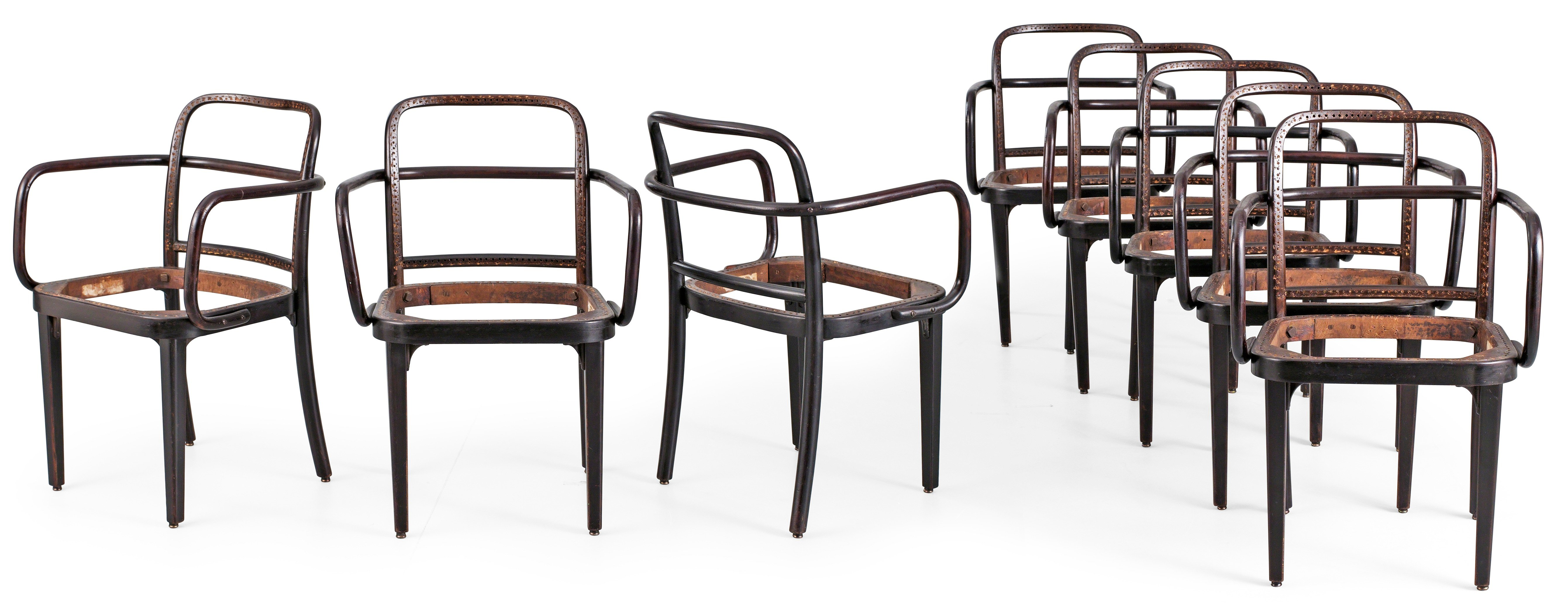 A set of eight dark stained bent wood chairs attributed to either