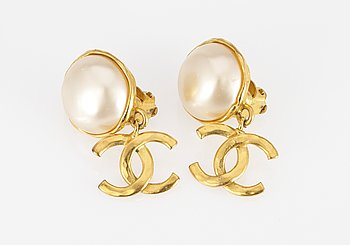 1. A pair of Chanel earclips.