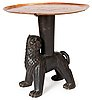 An anna petrus table, sweden early 1920's. by the artist, sculptured oak with an engraved copper tray.