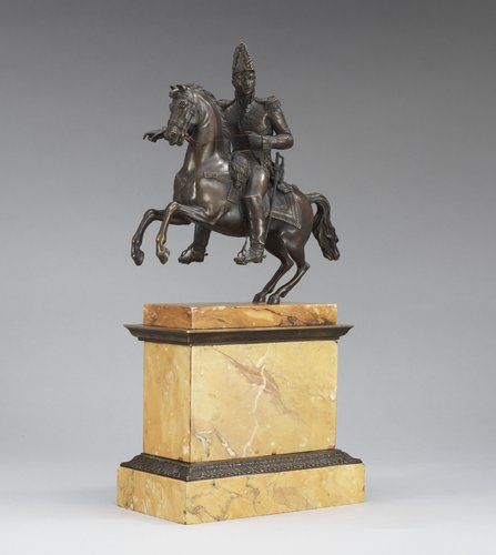 A french first half 19th century equestrian bronze and sienna marble veneered statue.