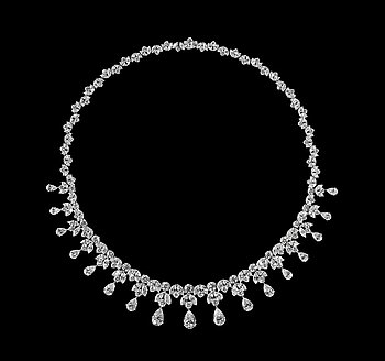 1001. An important diamond necklace, tot. 39 cts of drop- brilliant- and navett cut diamonds.