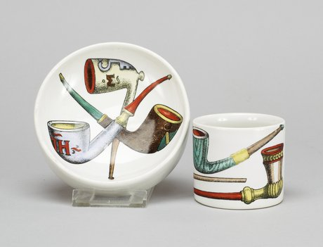 A fornasetti ash tray and cigarett stand.