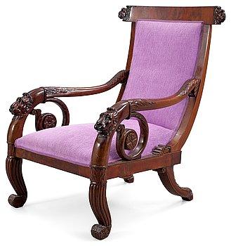 164. An Empire 19th century armchair.