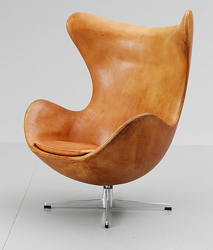 An arne jacobsen brown leather 'egg chair' by fritz hansen, denmark 1964.