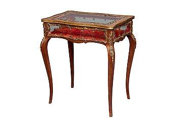 9. A VITRINE TABLE.
