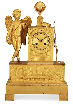 A French Empire early 19th century gilt bronze mantel clock. Height 43 cm, length 28 cm.