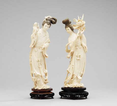 A pair of 20th century chines ivory figures.
